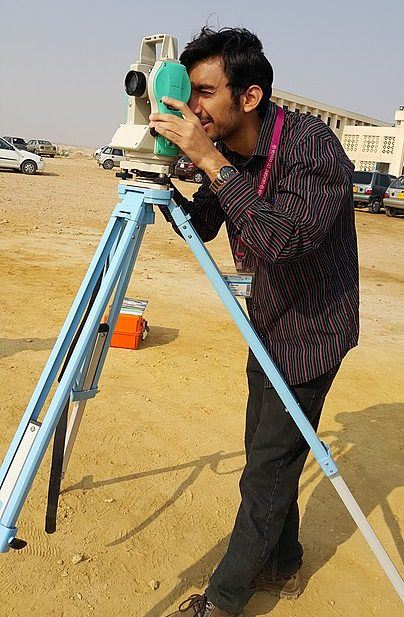 Surveyor using Theodolite in field